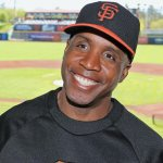Barry Bonds smiling a smile that tells anti-steroid crusaders to go fuck themselves